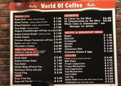 World of Coffee Menu Sign